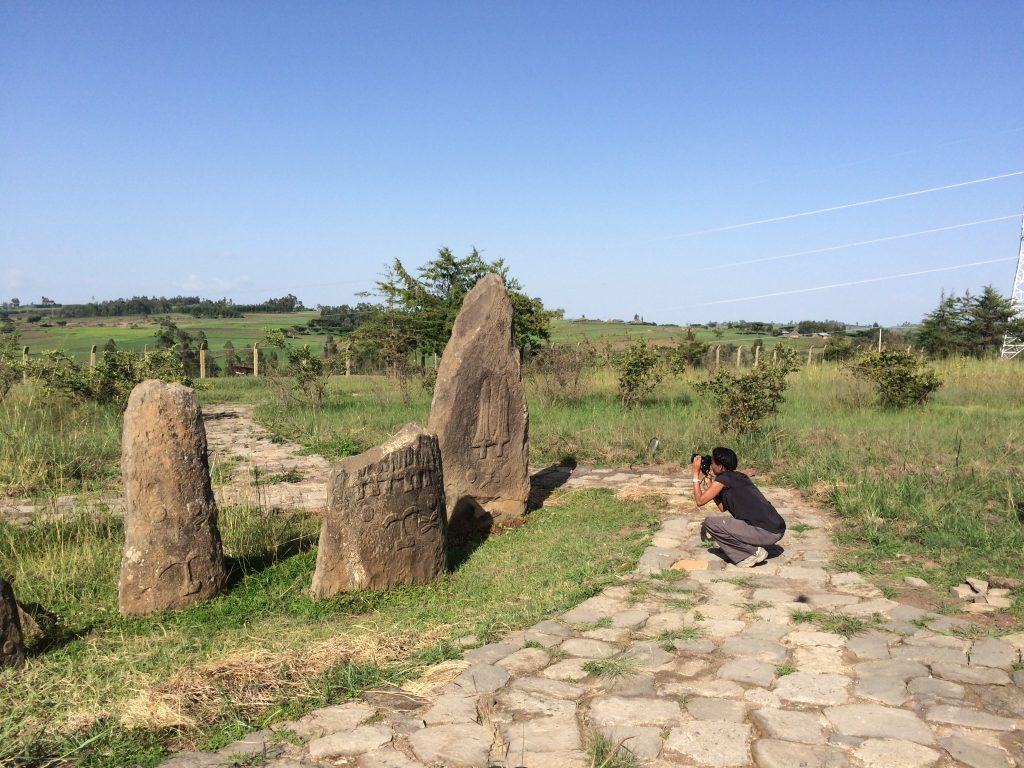 Dr Sada Mire at the decorated cemetery of Tiya, World Heritage Site, Ethiopia, 2015
