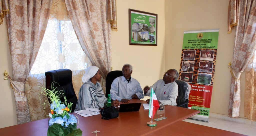 Sada Mire discussing the inclusion of a cultural heritage and archaeology chapter in the primary school curriculum with Minister and Deputy Minister of Education about school curriculum, Somaliland, 2011