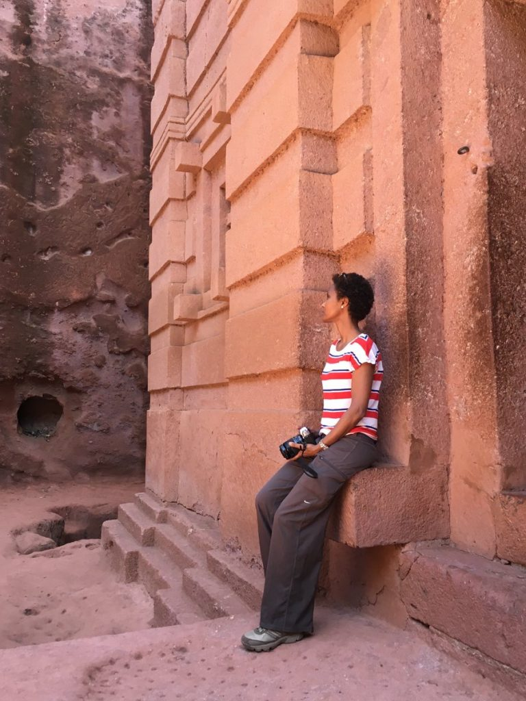 Dr Sada Mire admiring the breathtaking rock hewn churches of Lalibela, Ethiopia