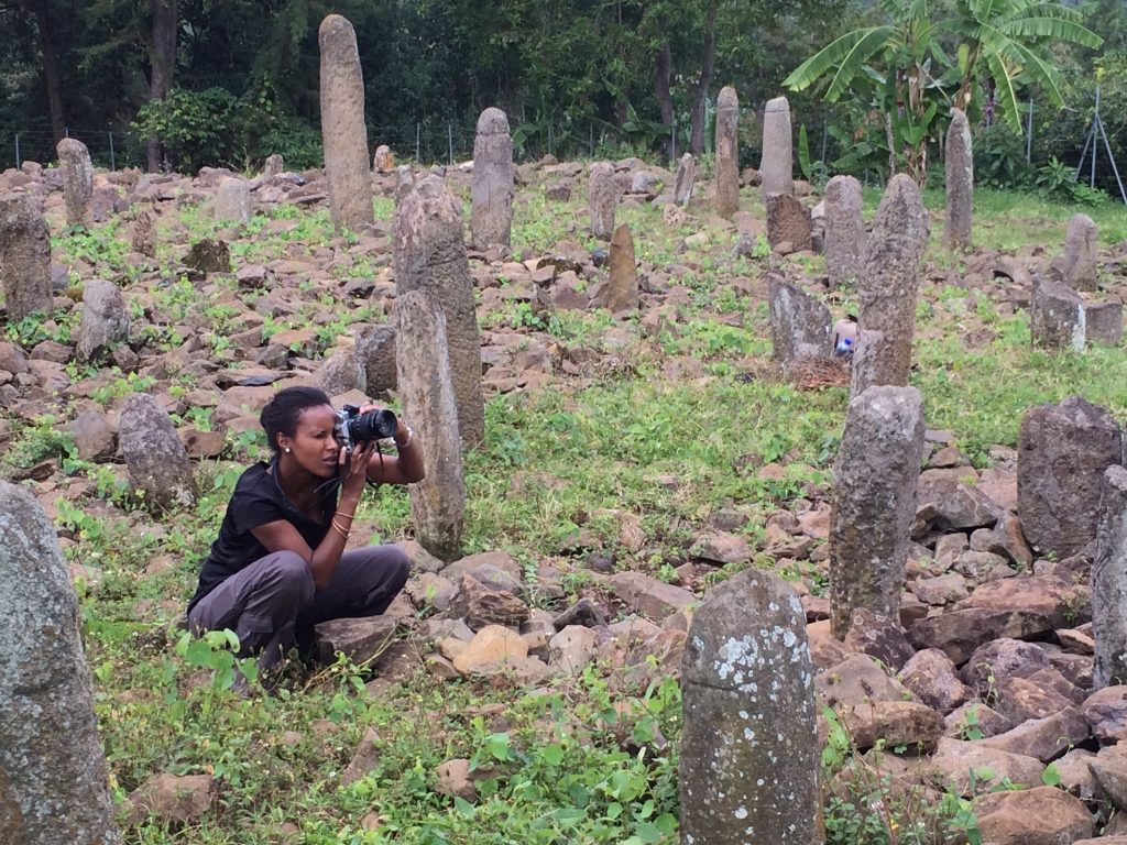 Dr Sada Mire investigating sacred landscapes in Ethiopia and photographing the Tuto Fela, World Heritage Site