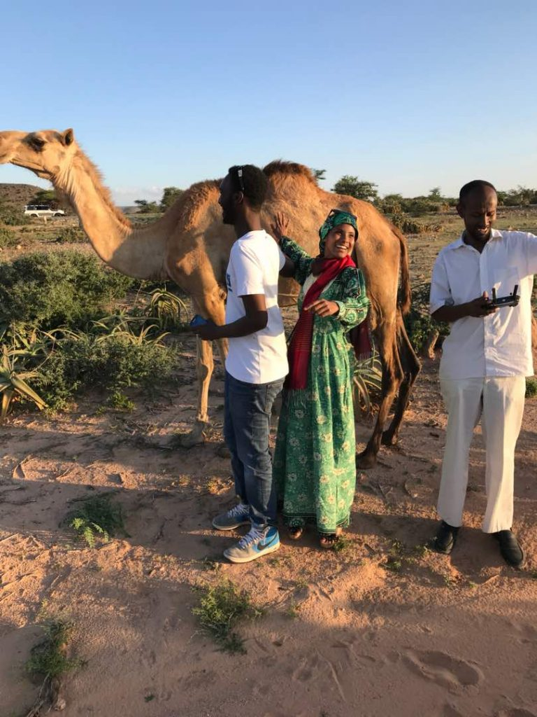 A beautiful camel with the Horn Heritage Drone team Mahamed Dahir and Sharmarke Sheikh  and Sada (Photo: Abdishakur Sulub)