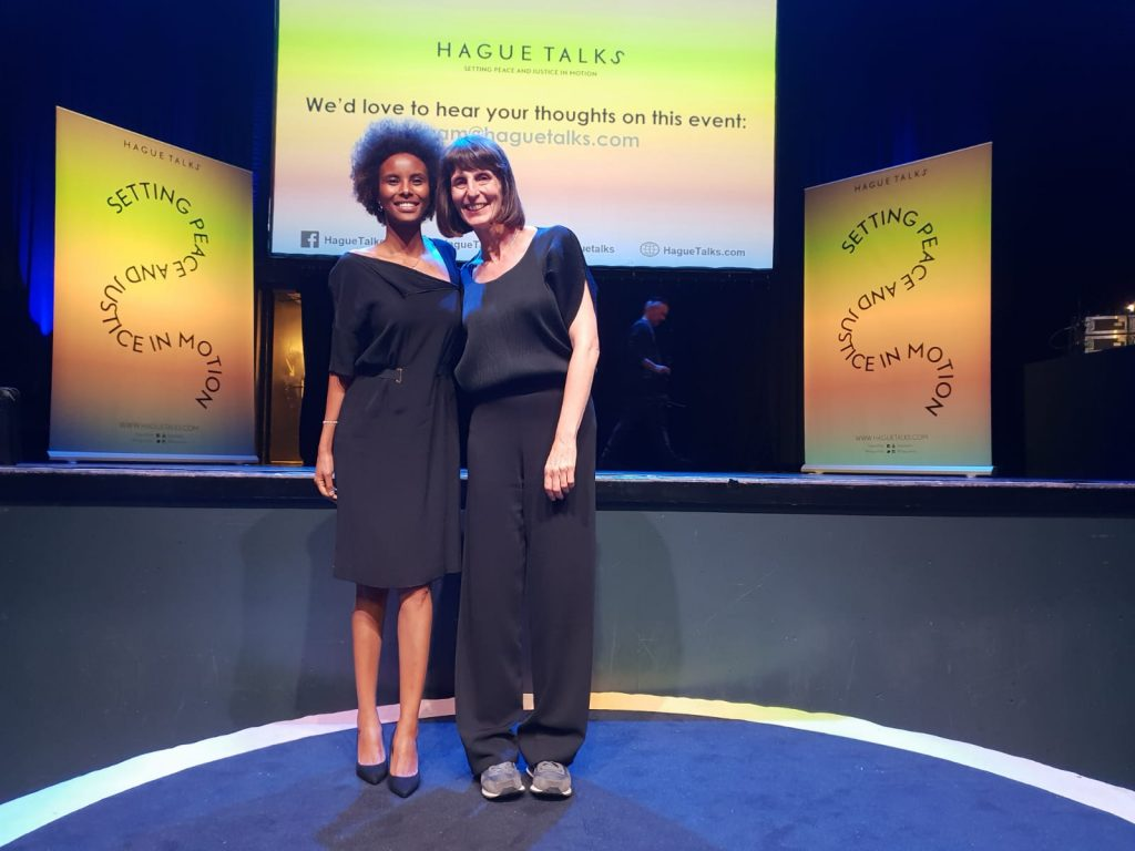 Sada Mire gives a HagueTalk 'Revize the History Books' at the Peace Festival. Photo with Deborah Abrahams at the Paard, The Hague, September 2018.