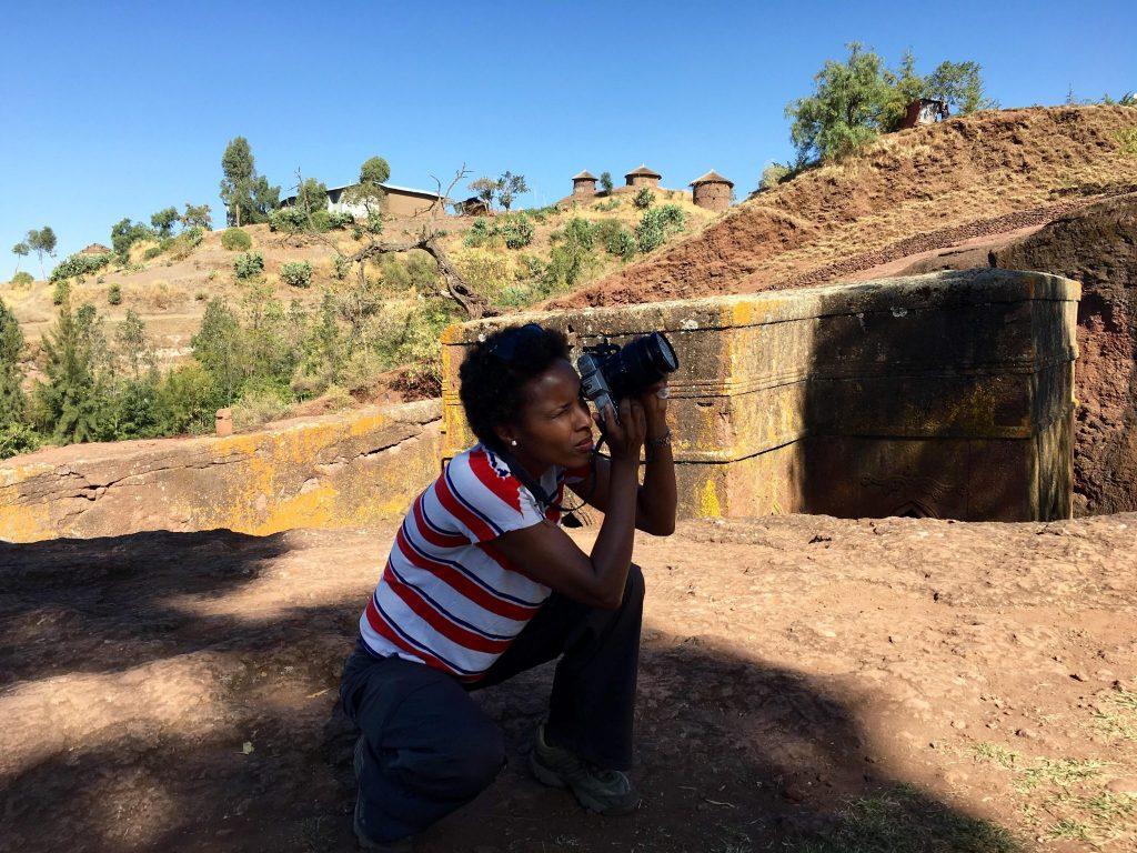 Dr Sada Mire at the rock hewn churches of Lalibela, World Heritage Site, sacred landscape in Ethiopia, 2015